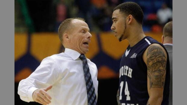 North Florida coach Matthew Driscoll (left) speaks with guard Dallas Moore during the second half against Illinois on Nov. 13, 2015 in Springfield, Ill. North Florida beat Illinois 93-81.