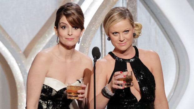 Tina Fey, left, and Amy Poehler host the 70th Annual Golden Globe Awards at the Beverly Hilton Hotel International Ballroom on January 13, 2013 in Beverly Hills, Calif.