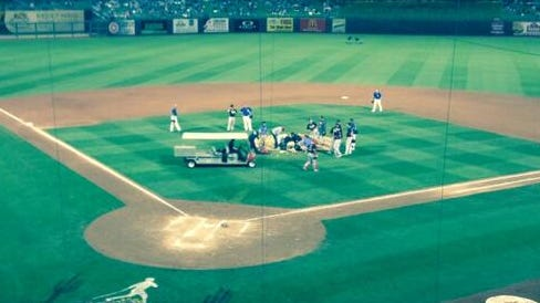 A stretcher is on the field to take Aroldis Chapman away.