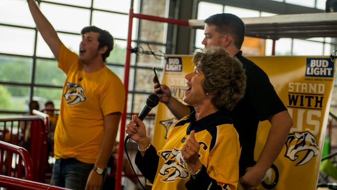 Clarksville Mayor Kim McMillan yells to Predators fans to get theme excited for Game 4 of the Stanley Cup Finals.