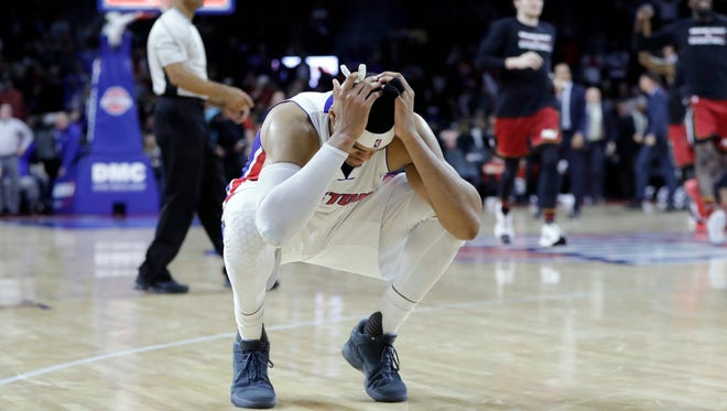 Pistons forward Tobias Harris reacts as the Heat celebrate their 97-96 win in the closing seconds Tuesday at the Palace.