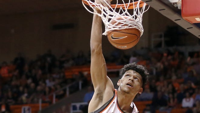 UTEP's Paul Thomas dunks during the Miners' game Saturday against Charlotte. Saturday's game was UTEP's final home game of the season.