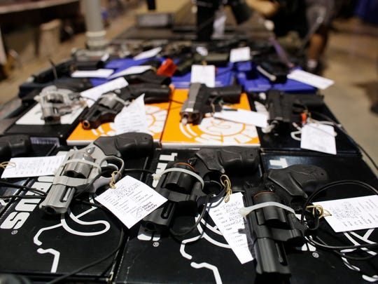 Handguns are seen at a gun show hosted by Florida Gun
