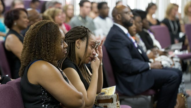 Family and friends attend funeral services for Scottsdale shooting victim Veleria Rascoe Sharp at Glory House International Church in Mesa on June 15, 2018.