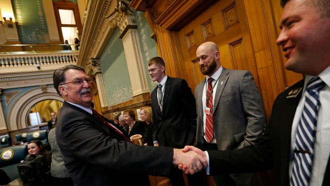 Patrick Neville, far right, shakes hands with a fellow lawmaker on  Jan. 13, 2016.