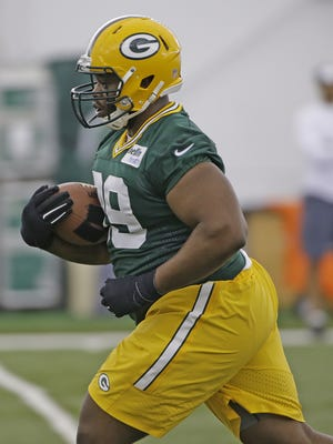 Green Bay Packers and ex-UL defensive lineman Christian Ringo (99) drills during rookie camp practice last May 6.