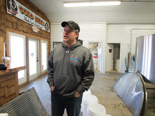 In this file photo, Brett McCrea, co-founder of 16 Mile Brewery in Georgetown.
