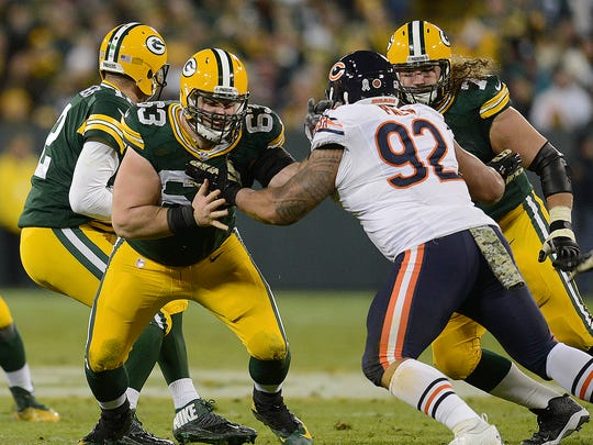 Green Bay Packers center Corey Linsley (63) and guard Josh Sitton (71) blocks for quarterback Aaron Rodgers (12) against the Chicago Bears .
