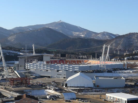 In this Dec. 12, 2017, photo, Pyeongchang Olympic Stadium is seen in Pyeongchang, South Korea. After two straight balmy Olympics where some might have wondered if it was even winter, let alone the world's pre-eminent freeze-dependent sporting event, athletes and visitors alike will finally experience a no-joke chill in their bones. Vancouver and Sochi got complaints for being too warm, as might Beijing in 2022, but the weather in Pyeongchang will likely dazzle spectators, and confound organizers and athletes, in its bitterness.(AP Photo/Ahn Young-joon)