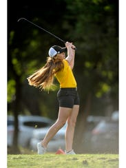Blanket's Cassie Furry tees off on the first hole during the first round of the Class 1A UIL state golf tournament in 2017 at Lions Municipal Golf Course in Austin.