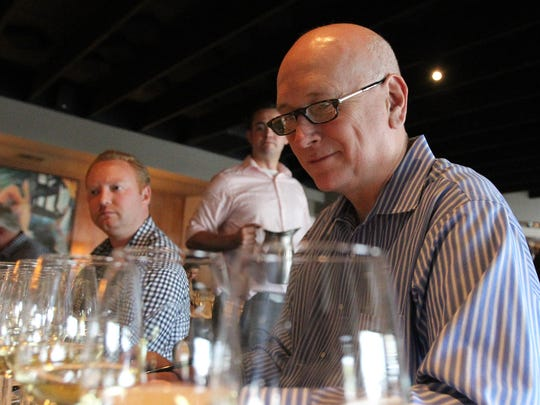 Patrick Norton, with J&G Steakhouse, eyes his next wine at The Arizona Republic Wine Competition at Tarbell's in Phoenix,  Arizona on October 26, 2015. (Photo by Ben Margiott/The Republic)