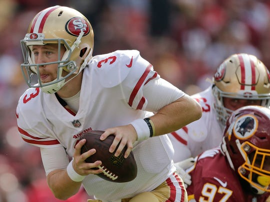 San Francisco 49ers quarterback C.J. Beathard (3) scrambles with the ball during the first half of an NFL football game against the Washington Redskins in Landover, Md., Sunday, Oct. 15, 2017.