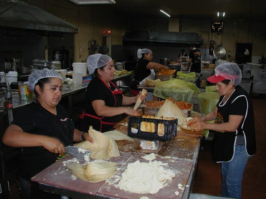 Among the ladies who make each and every tamale by hand are, from left, Yuri Navarro, Romelia LeDesma, Maria Valle Baltrazar and Maria Salamanca. Their goal is 300 dozen tamales a day in a 6 a.m. to 2 p.m. shift.