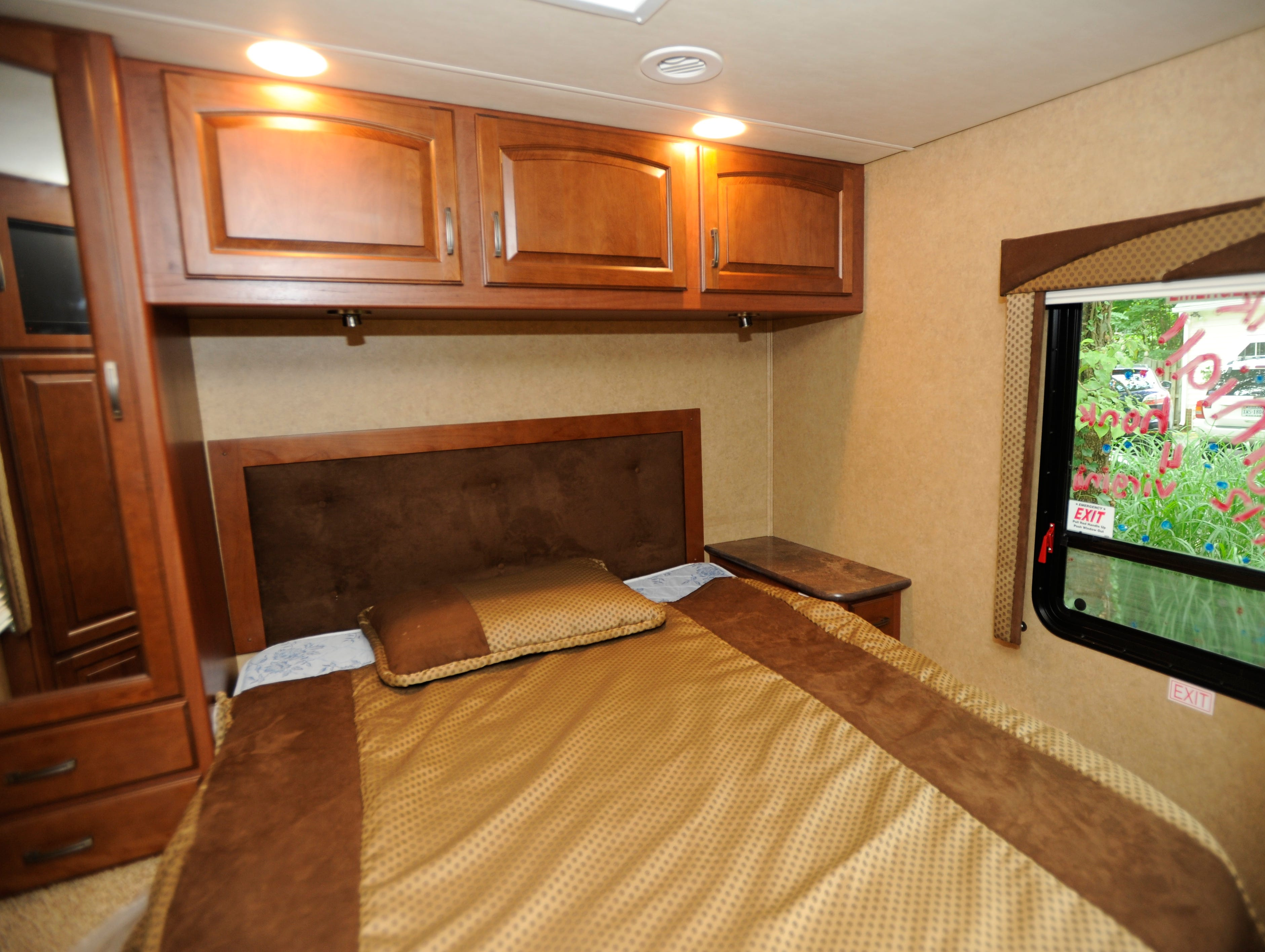 The back end of the RV is a bedroom.