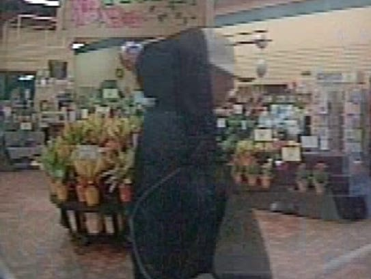 A photo of a bank robbery suspect inside Crossroads