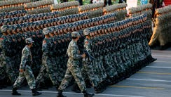 Chinese soldiers march into position ahead of a military