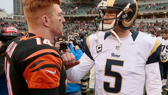 Cincinnati Bengals quarterback Andy Dalton (14) and St. Louis Rams quarterback Nick Foles (5) talk after the fourth quarter of the NFL Week 12 game between the Cincinnati Bengals and the St. Louis Rams at Paul Brown Stadium in Cincinnati, on Sunday, Nov. 29, 2015. The Bengals routed the Rams 31-7, improving to 9-2.