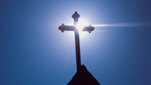 Silhouette of a cross on the roof of a church, Greece