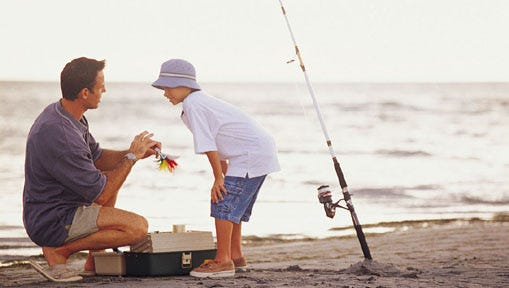 Father teaching son to fish.