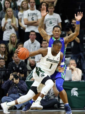 Michigan State guard Joshua Langford (1) drives to the basket against Florida Gulf Coast during the first half Sunday at Breslin Center.