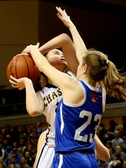 Chassell's Sydney Danison (20) goes for the basket as Adrian Lenawee Christian's Dani Salenbien (23) defends against her during the first half of Lenawee Christian's 57-36 win in the Class D state final at Van Noord Arena at Calvin College in Grand Rapids on Saturday, March 17, 2018.
