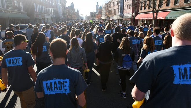 Students from all over Ross County came together to march to the Ross County Courthouse during a My Attitude Determines Everything (M.A.D.E.) anti-drug program rally Friday in downtown Chillicothe.