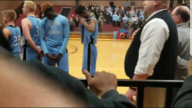 Kabbash Richards, a Lansing Catholic basketball player, decided Tuesday night to not face the American flag during the national anthem. The anthem played before the team's game at Okemos High School.