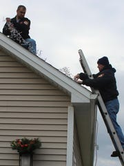 1026 - Volunteers from the Fayetteville Fire Department help decorate the Stinson home