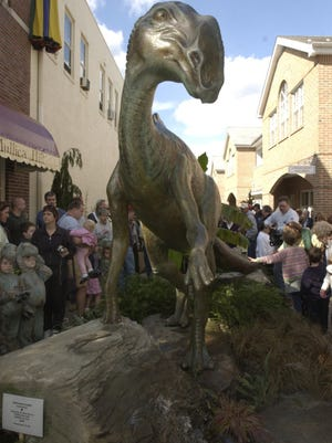 File: A large crowd gathers to admire the new dinosaur statue in Haddonfield Saturday. 10/18/03