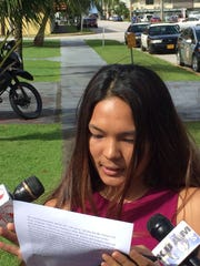 Ashlee Santos on Nov. 2, 2016, issued a statement outside the Guam Police Department, in Hagåtña, accusing school Principal Eleuterio Mesa of sexual harassment.