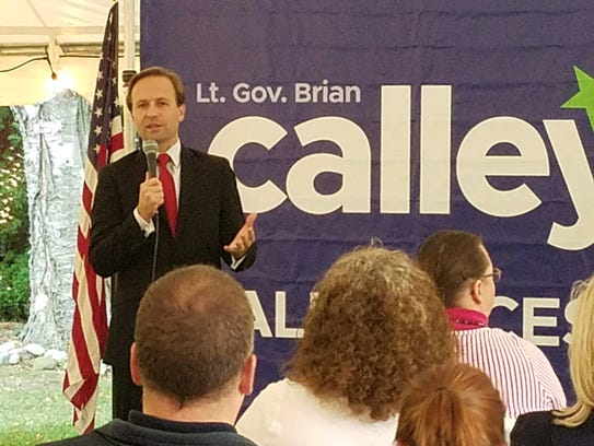 Michigan Lt. Gov. Brian Calley talks with residents