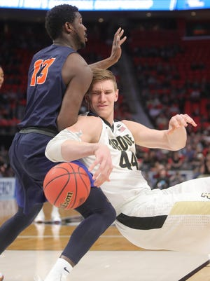 Purdue center Isaac Haas is defended by against Cal State-Fullerton forward Arkim Robertson during the first half of Purdue's win in the first round of the NCAA tournament on Friday, March 16, 2018, at Little Caesars Arena.