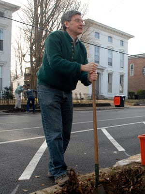 Metro Councilman Bill Hollander helped dig a hole during a neighborhood tree planting in Butchertown.