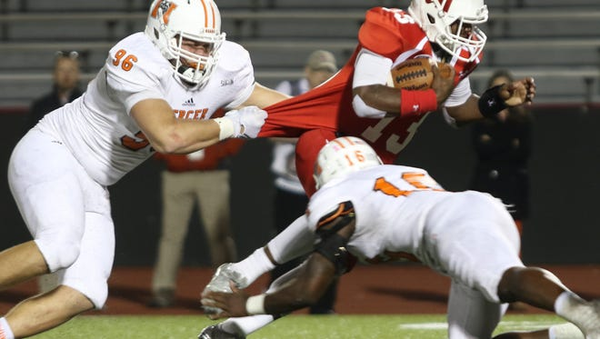 Austin Peay true freshman JaVaughn Craig (13) tries to escape Mercer defenders during their game on Oct. 22, 2016 at Fortera Stadium. Craig started the season as a redshirt.