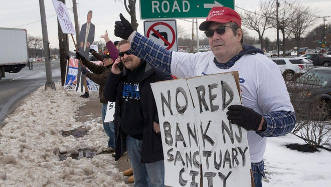 Fans of President Donald Trump rally outside the Middletown Plaza on Feb. 11, to call for more Americans to support him. Another such rally is scheduled for Monday.