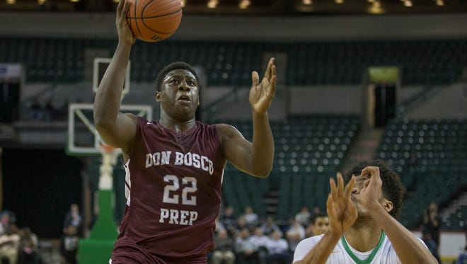 Don Bosco's Marcellus Earlington drives to the basket past The Patrick School's Nicholas Richards in the Tournament of Champions Final at  Sun Center in Trenton on March 20, 2017.