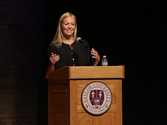Whitney (Cerak) Wheeler addresses a crowd during a