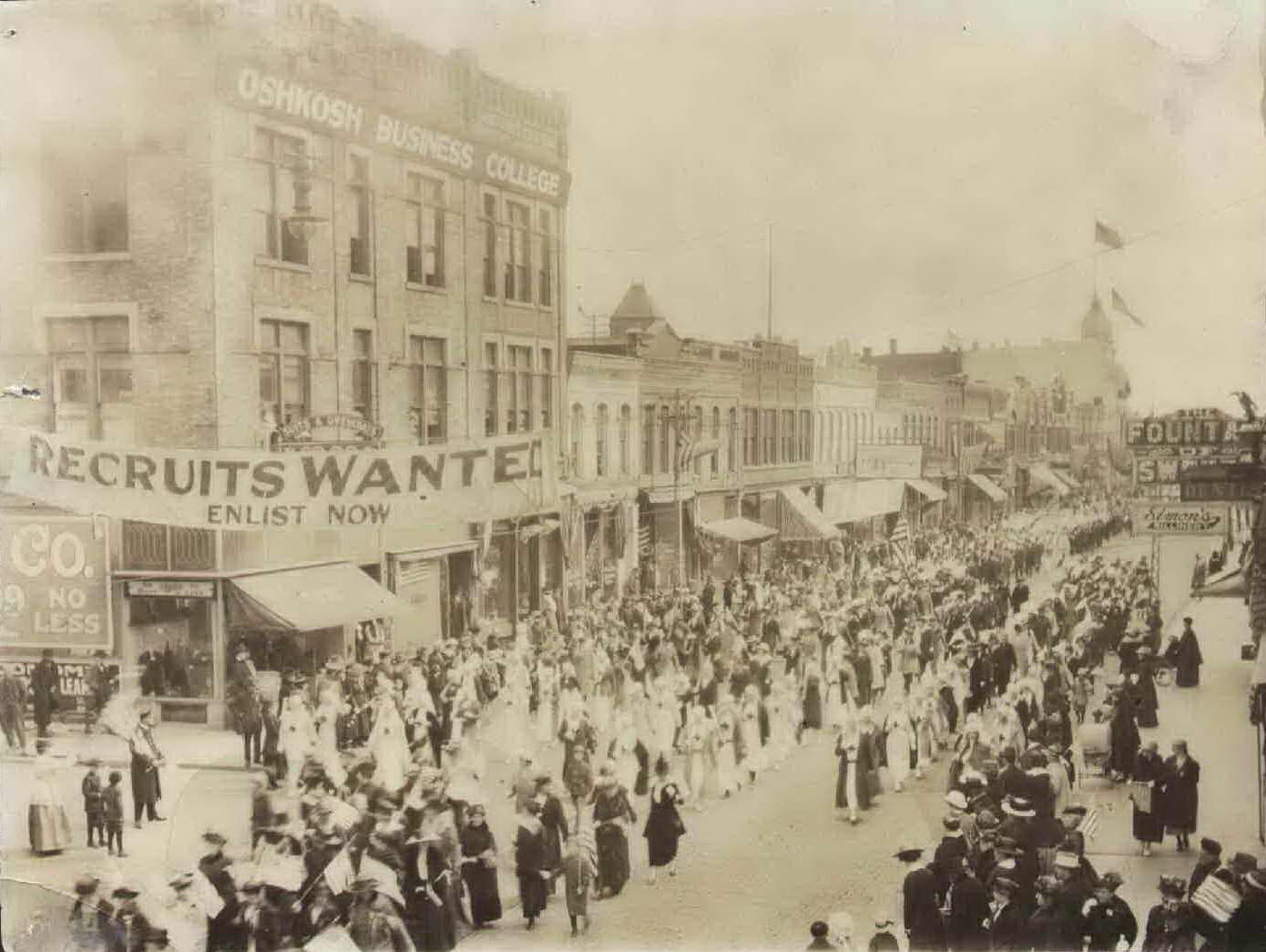 A group of Red Cross nurses parades past Merritt Avenue