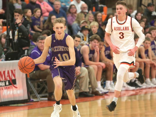 Lexington's Kyle Johnson dribbles the ball in front of Ashland's Garrett Denbow during Thursday night's Ohio Cardinal Conference game.
