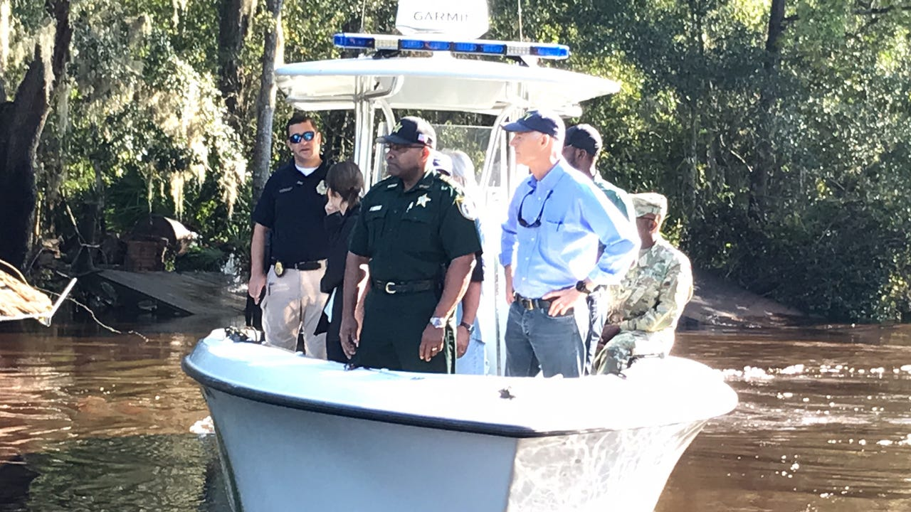 Scott toured Black Creek by boat after several people were rescued from a flash flood.