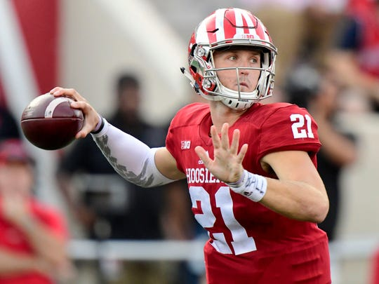 Hoosiers quarterback Richard Lagow (21) throws the ball during the second half of the game at Memorial Stadium. The Indiana Hoosiers defeated the Maryland Terrapins 42 to 36.