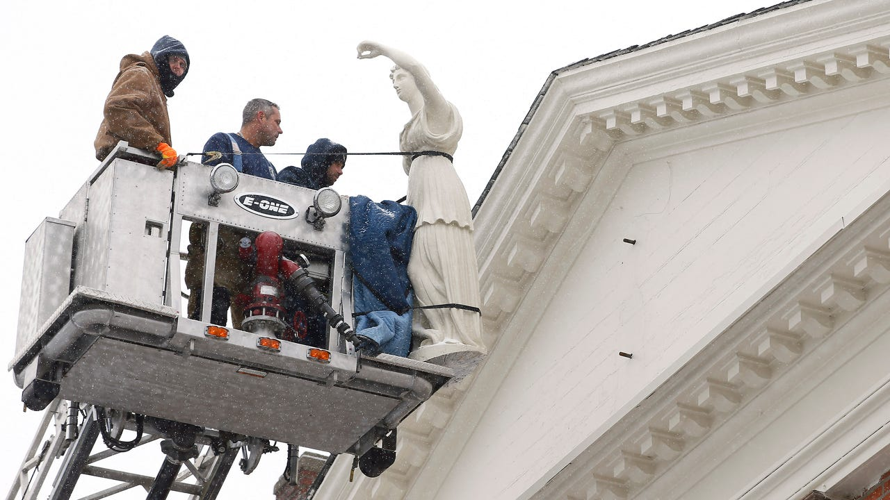 The installation of Morristown's Lady Justice was cancelled. Crew had trouble aligning bolts that attach Justice to the tympanum, the ornamental ledge on which Justice stands just below the roof of the Morris County Courthouse.
