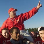 Delsea football coach Sal Marchese Jr. is carried off the field by his players after a 2000 game. As a player, he was vital to the team's 1984 win over Glassboro.