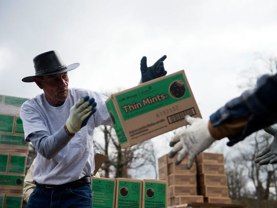 Larry Phillips of Clinton helps load Girls Scout cookies into the back of a truck in Chilhowee Park Wednesday February 15, 2017.