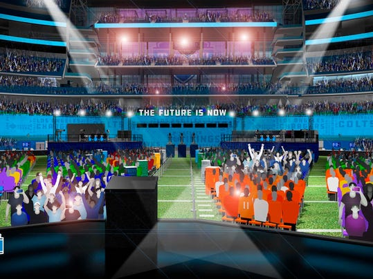 This computer rendering provided by the NFL shows the on stage view of the proposed NFL Draft at AT&T Stadium in Arlington, Texas. The NFL is bringing its Big D, the draft, to Dallas Cowboys owner Jerry Jones' palace. This draft, the first in a stadium, will pay homage in so many ways to the cliche that everything is bigger in Texas. (NFL via AP)