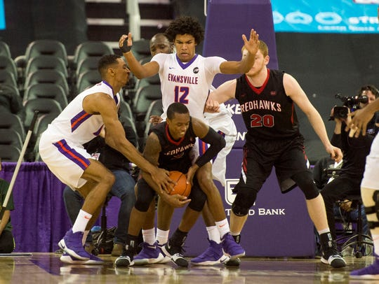 Ryan Taylor (left) and Dru Smith (center) guard Southeast Missouri Redhawks at Ford Center last season. Each transferred to Power 5 colleges after Marty Simmons was fired.