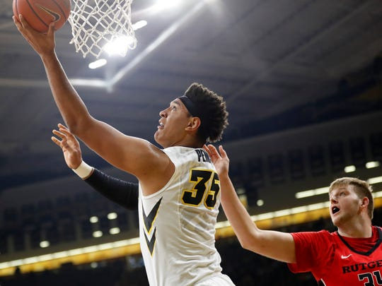 Iowa forward Cordell Pemsl (35) drives to the basket past Rutgers center C.J. Gettys, right, during the first half of an NCAA college basketball game, Sunday, Jan. 8, 2017, in Iowa City, Iowa. (AP Photo/Charlie Neibergall)