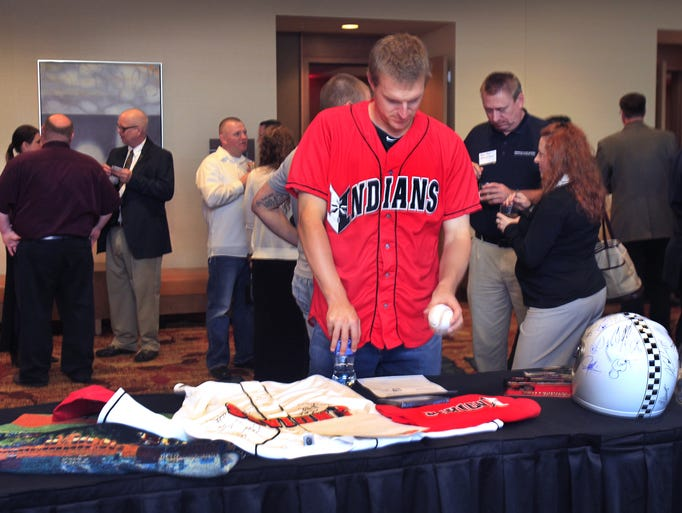 "Adam Wilk, a 6'2"" left-handed pitcher for the 2014 Indianapolis Indians looks at some of the items up for bid at a silent auction held at the Indians First Pitch Party's private reception at the JW Marriott in downtown Indianapolis on Tuesday, April 1, 2014."