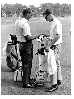 Bob Burns (right) talks about clubs with golfing great Arnold Palmer at Gary (Ind.) Country Club in 1967.