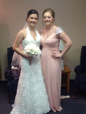 Bride Jeni Reed and bridesmaid Witni Kilworth scrambled to find bridesmaid dresses when the West Des Moines bridal salon Selina's Bridal Boutique failed to deliver the correct gowns.